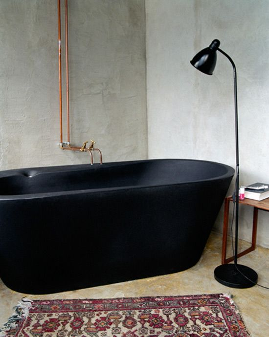 Black stone bath with copper taps. www.desiretoinspire.net
