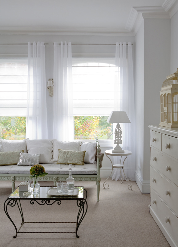 A combination of curtains and blinds allows you to diffuse the light in a sunny room. Source: Room styled by Sophie Robinson. Image from Decora