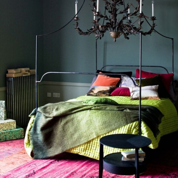 dark moody bedroom interior design with bright green and red accents