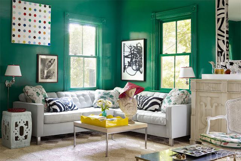 emerald green walls in gloss finish with yellow tray and pop art, zebra print cushions, sash windows, sophie robinson