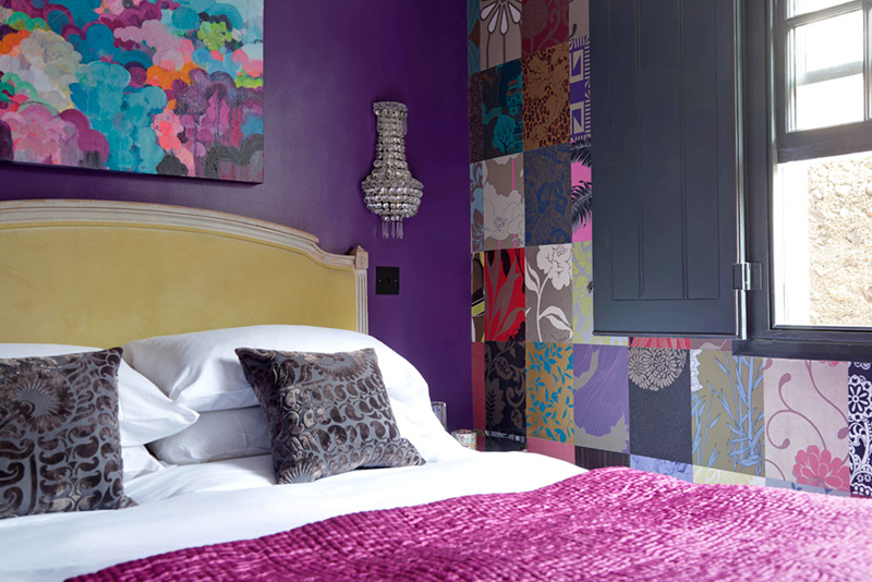 guest bedroom feature wall patchwork wallpaper