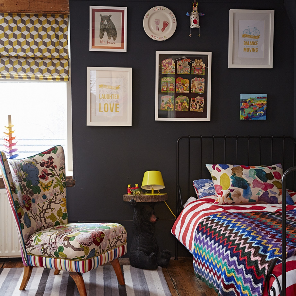 Kids bedroom designed by Sophie Robinson in her signature black with pops of bright colour which is ideal for a kids room as the brights look striking against the dark interior. photograph by Alun Callender
