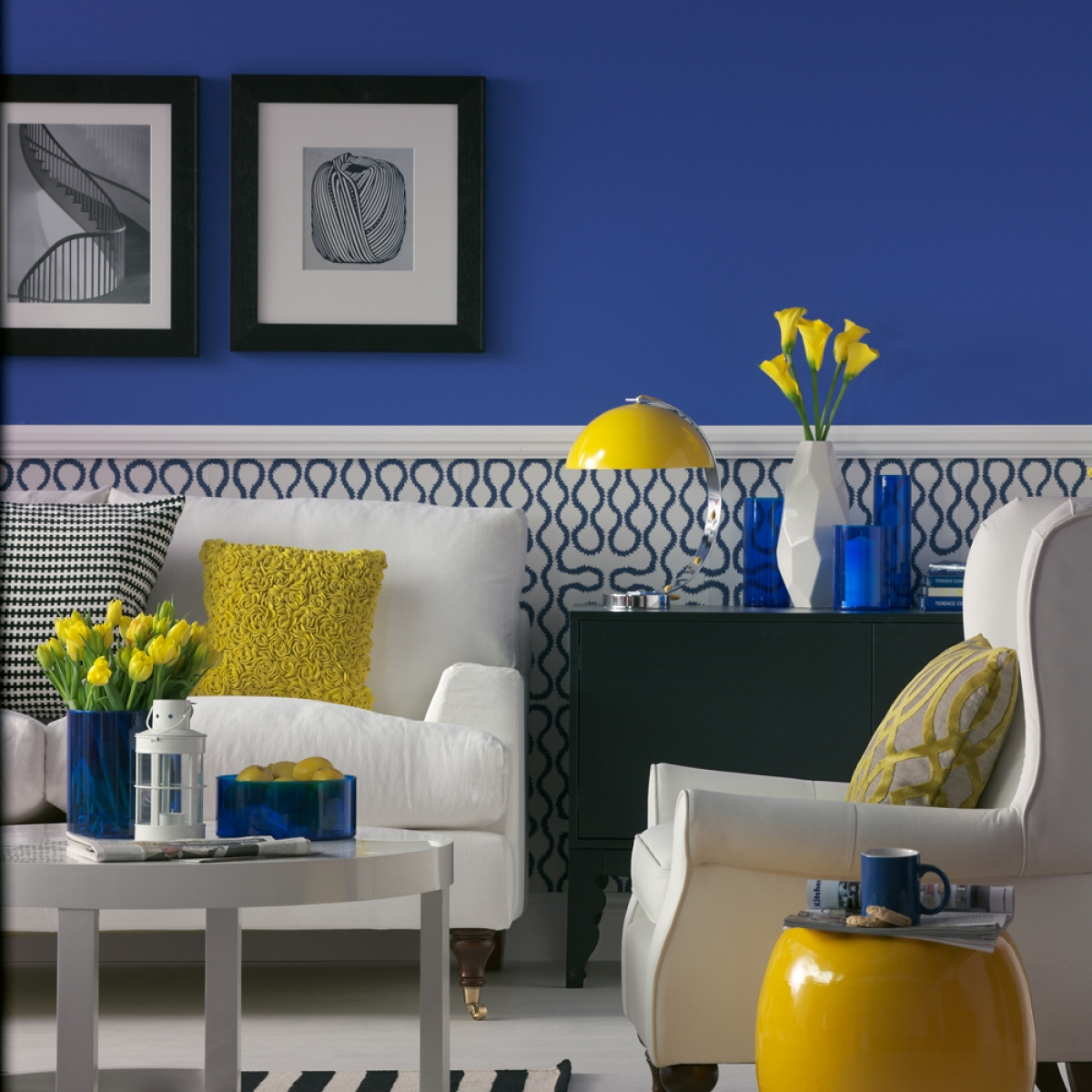 Bright blue living room scheme designed by Sophie Robinson. Photograph by Dominic Blackmore