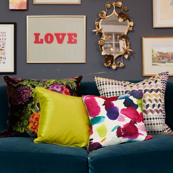 Sophie Robinson mixes patterns using cushions on a sofa in a living room
