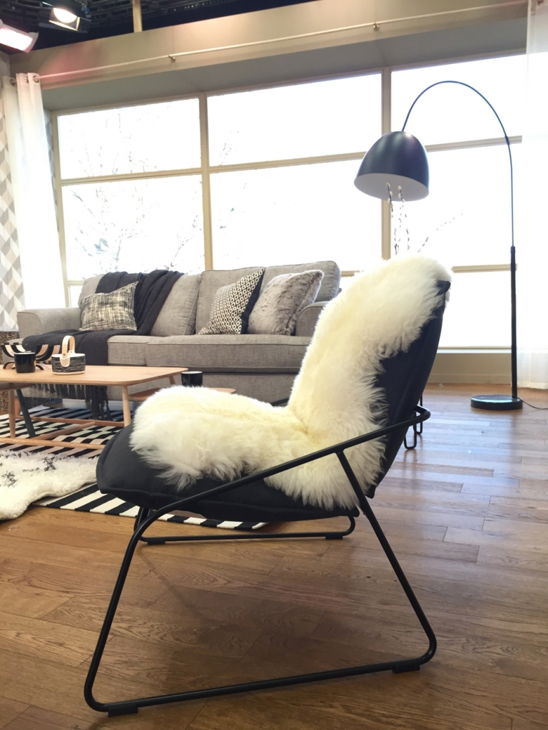 Get the Scandinavian look for interior design. Sheepskin throw over an Ikea Armchir. Styled by Sophie Robinson