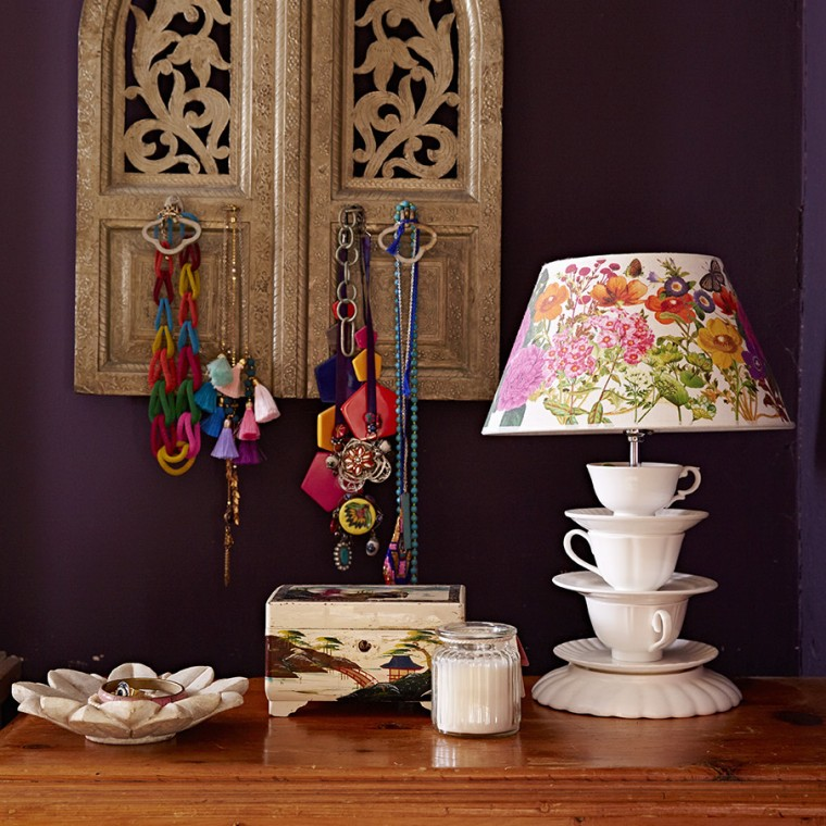Sophie Robinson interior designers home. Statemet necklaces and a teacup lamp