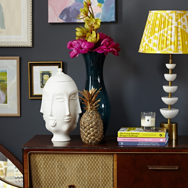 Styled objects on a vintage radio gram in the home of Sophie Robinson