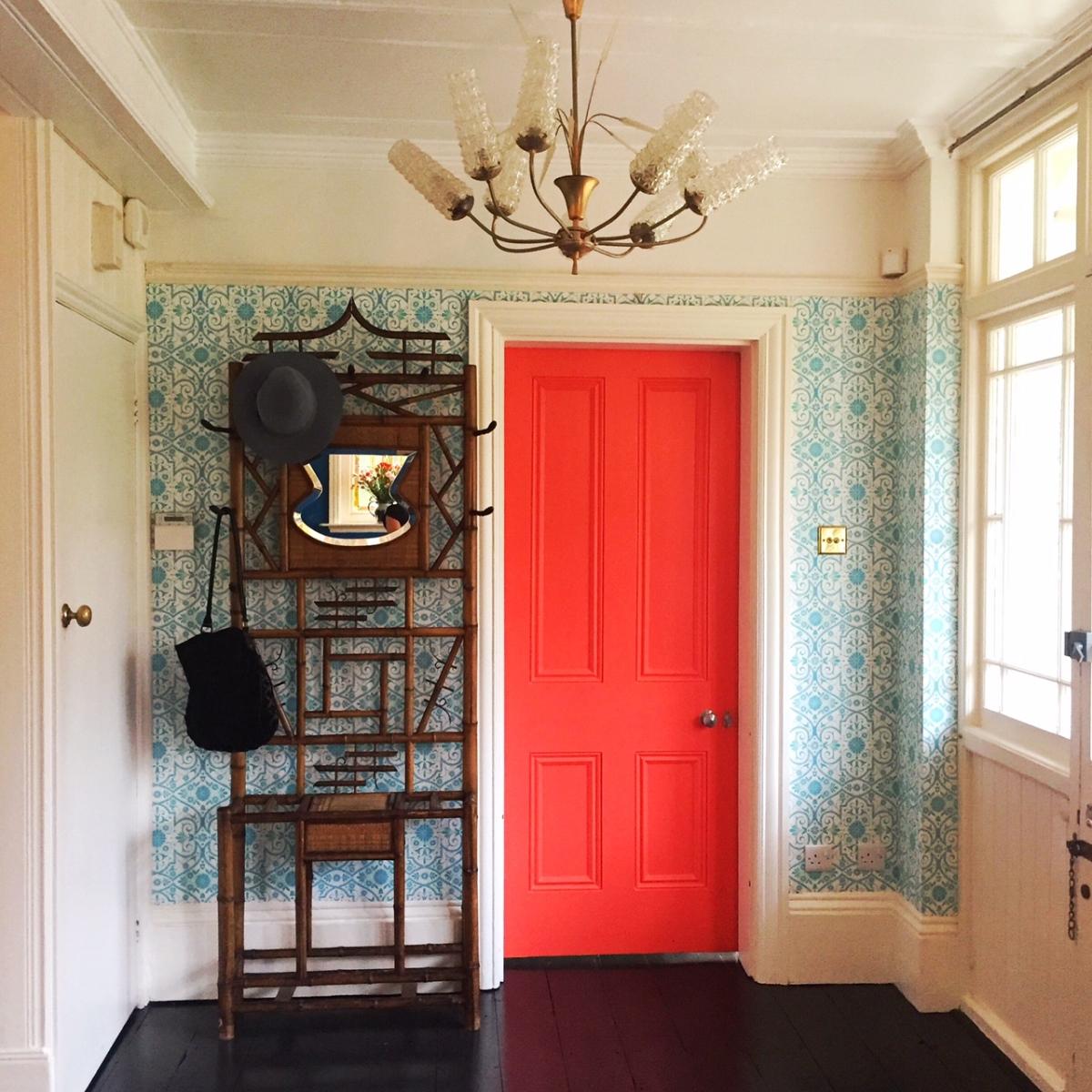 Orange door in the home of Sarah Mitchenall winner of the Great Interior Design Challenge