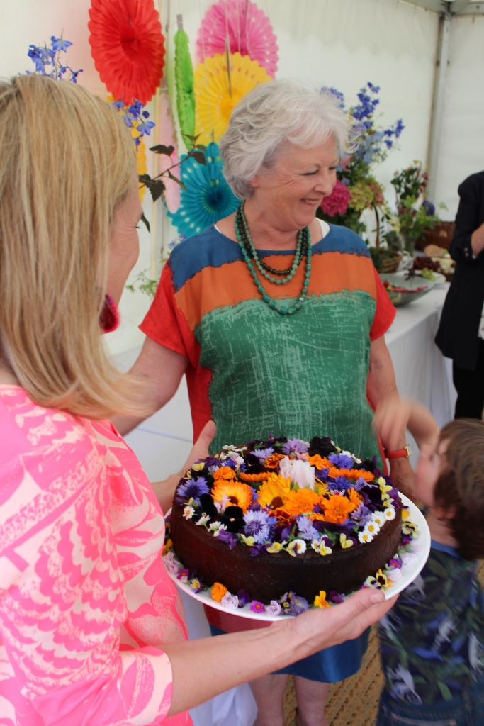 My chocolate orage cake, decorated with edible flowers is the perfect recipe for a celebration birthday cake. I dressed it with flowers for my Mums 70th birthday summer garden party