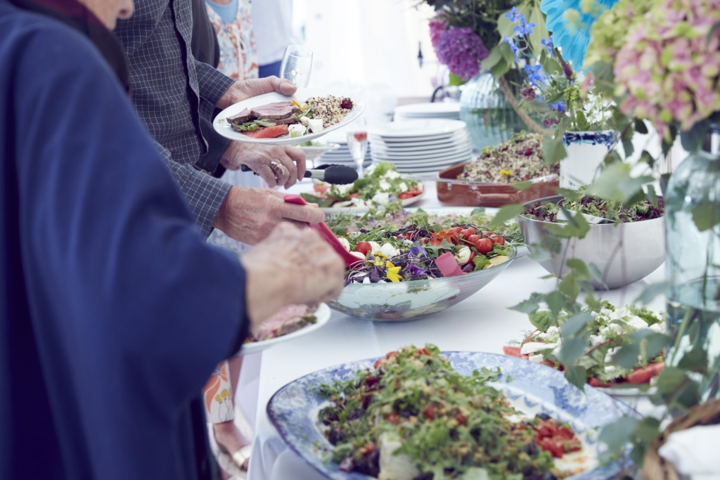 A delicious buffet style lunch is the most versitile choice for a relaxed summer garden party. Arrange food in large dishes and dress with fresh herbs and edible flowers. This spread was provided by Blid and Hatton
