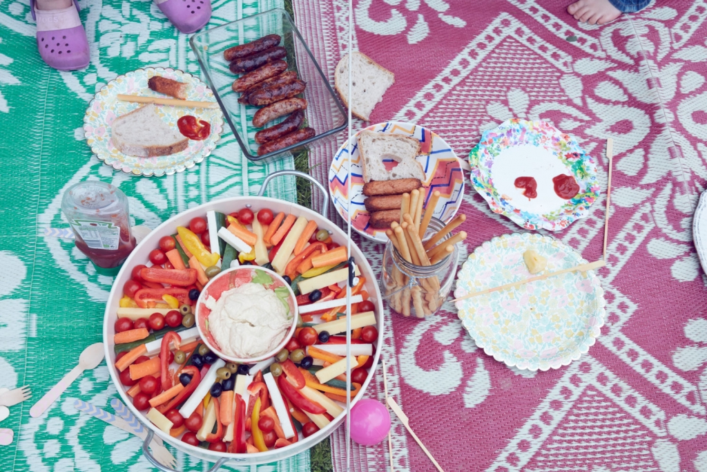 If you are throwing a garden summer party then create large platters for the kids picnic lunch and arrange on rugs in the garden