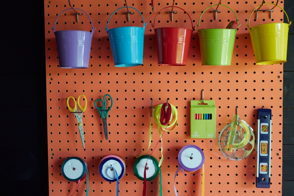 A peg board is the perfect way of maximising small spaces and getting storage up onto the walls. Every well interior designed space needs effective practical soloutions, especially creative spaces. Here all the craft and upcycling materials are kept in the same place.