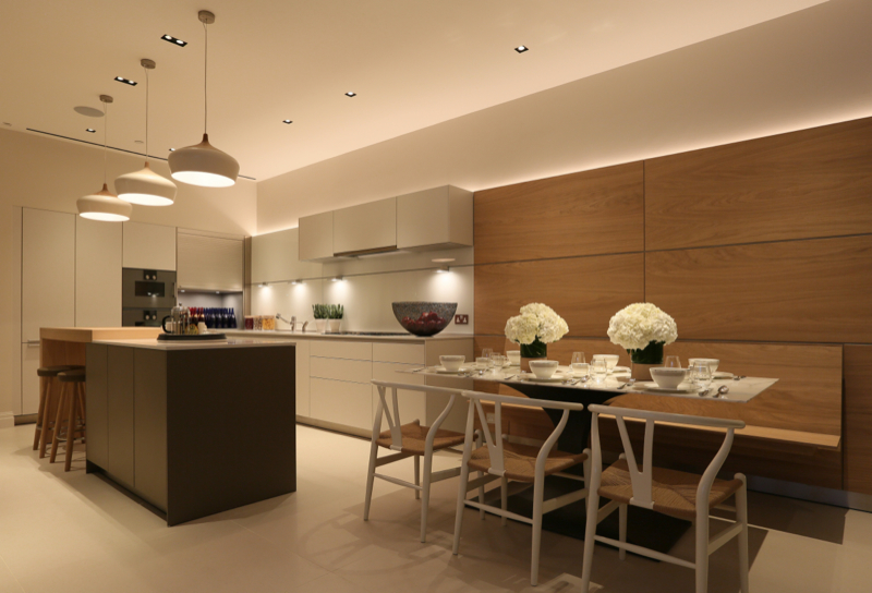 Kitchen lighting design, including pendants, spots and recessed lighting in a modern London kitchen, the home of John Cullen Lighting designer sally Storey