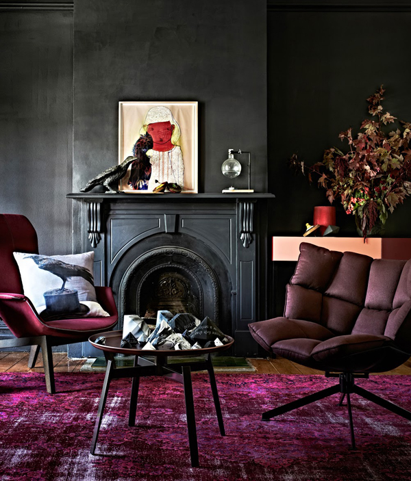 inky black living room with rich purple rug