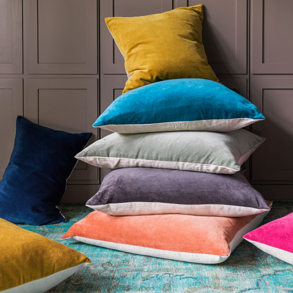 Sumptuous velevet and linen scatter cushions add colour to an autumnal interior design scheme