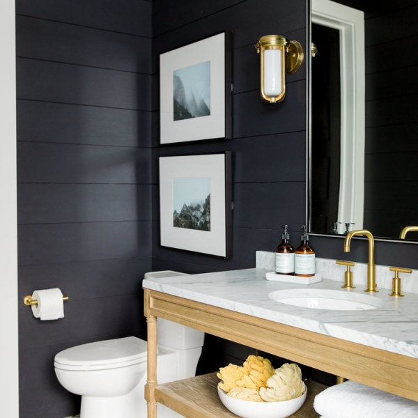 Black shiplap bathroom with dark walls, encaustic tiles and vanity unit