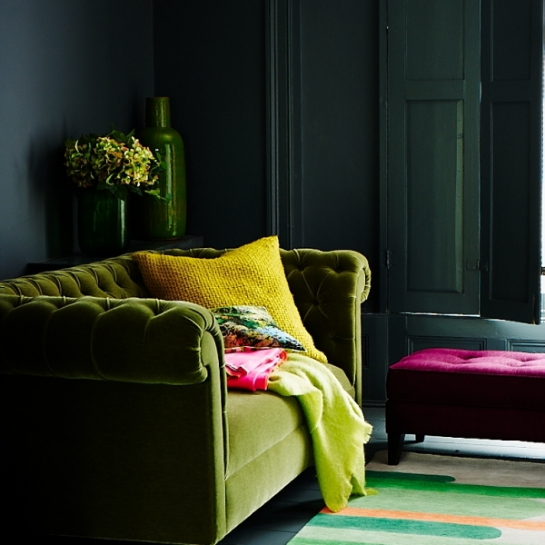 Green velvet sofa set inside a inky dark interior. Styled by Mary Norden for Red magazine