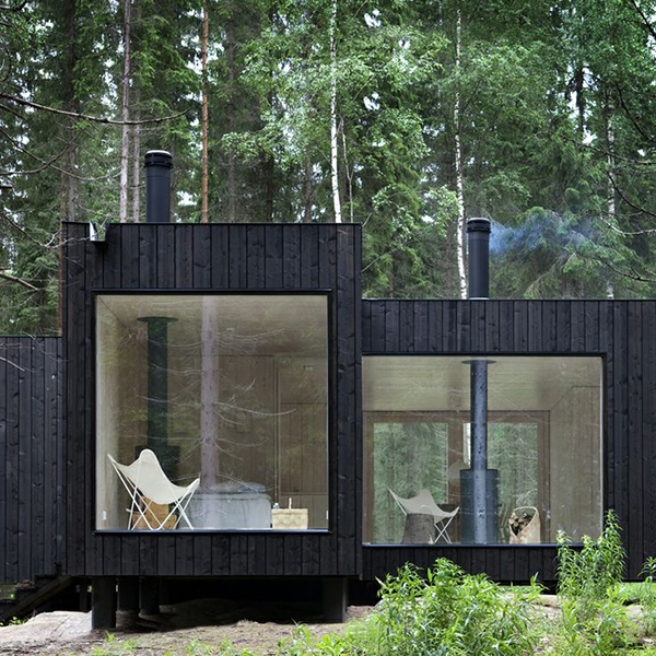 black weatherboard cabin on the woods