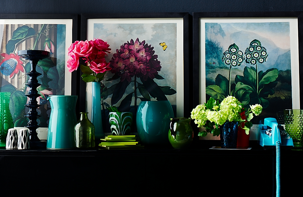 Collection of teal and turquiose glazed vases styled on a shelf by Interior stylist Mary Norden