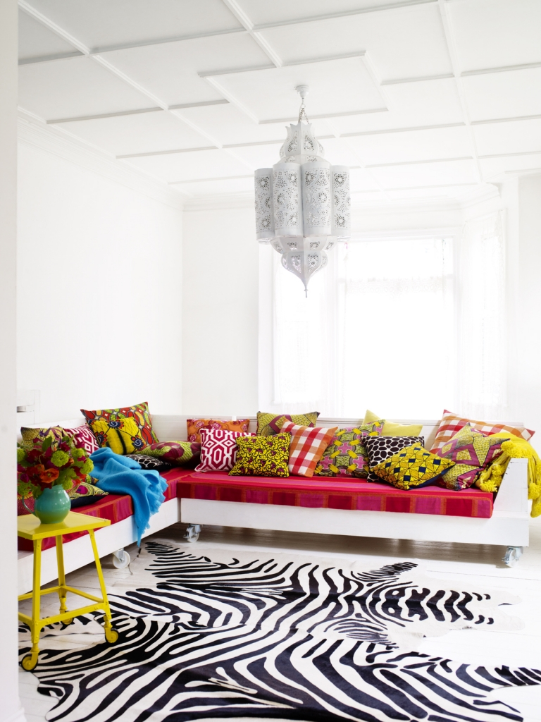 Living room with modular sofa and patterned scatter cushions. Interior Stylist Mary Norden clashes and mixes pattern to a riotous effect. As seen on www.sophierobinson.co.uk