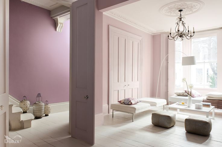 soft pink walls and white painted floor in a victorain living room