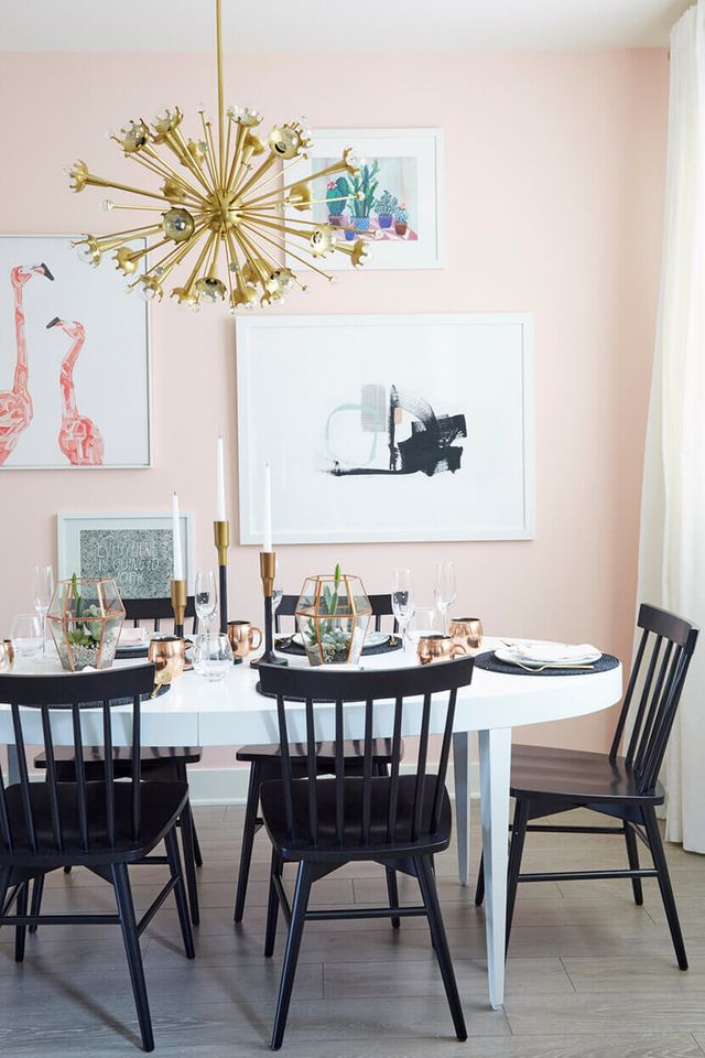 pale pink dining room with black chairs and gold sputnik lamp. Styled by Emily Henderson