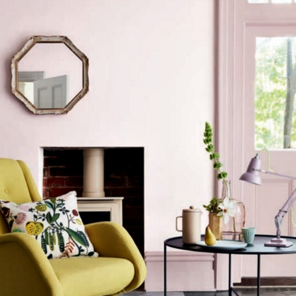 pale pink walls in livingroom is freshened up with lime yellow mid century modern chair. walls painted in Dorchester mid by Little Green paint