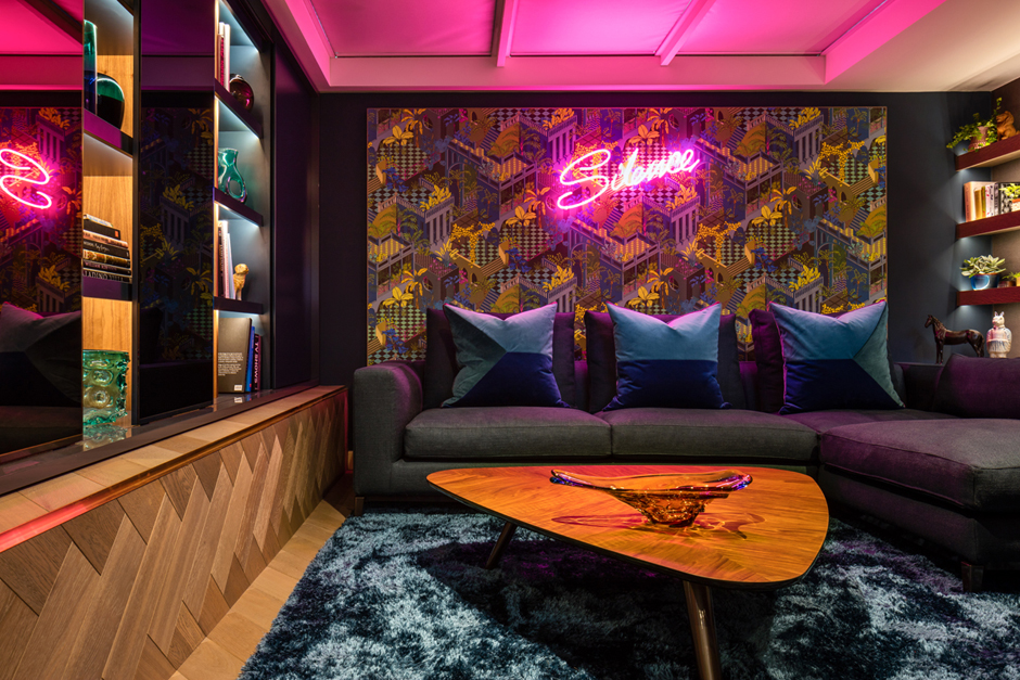 The winter personaity loves high drama and making striking statements. This neon pink sign ad graphic cole and son wallpaper is perfect. Room designed by Daniel Hopwwod