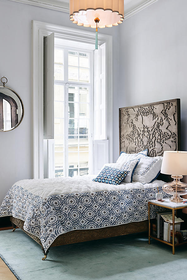 The texture and craft detail on this oversized headboard, along with the block printed fabrics make this an ideal room for an Autumn personalityhand carved Odelina bed from Anthropologie.