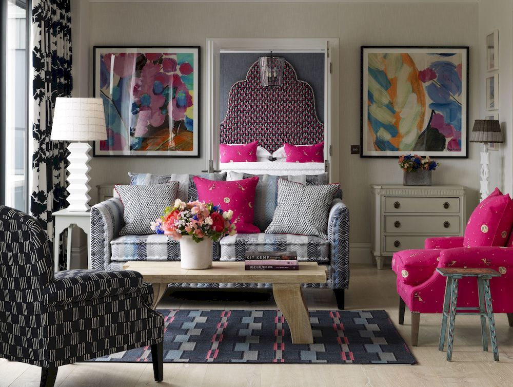 The winter personailty loves high drama and staurated colour. This room designed by Kit Kemp for Firmdale hotels show her love of colour with the hot pink armchair, graphic fabrics and oversized large headboard in the back ground