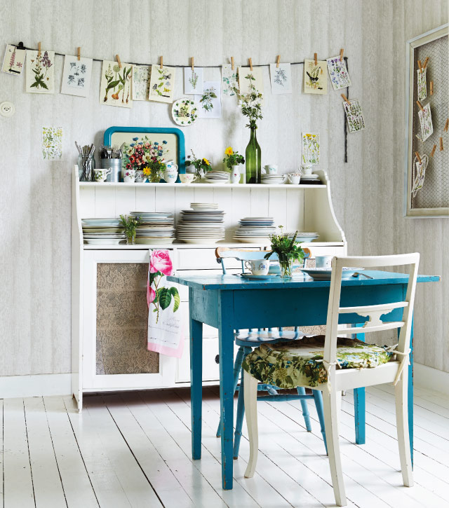 The Spring personality in terms of Colour Pscychology is fresh and vibrant and torally creative. This vintage workspace with its collection of botanical prints is set against fresh white tongue and groove walls. Image by Selina Lake, Botanical Style