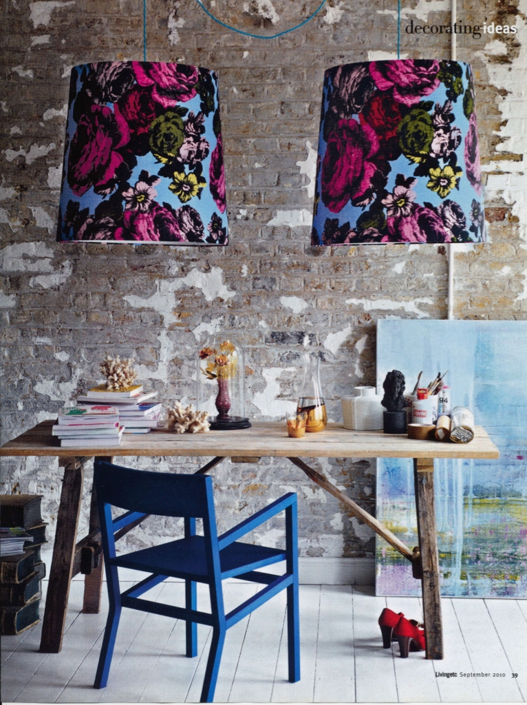 Oversized floral statement lampshades makes the strong statement here. Exposed brick walls and raw timber table lend it to the Autumn personality when looking at colour Pscychology