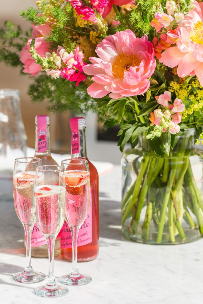 Pink peonies and champagne served with a fresh strawberry to combat the english heatwave