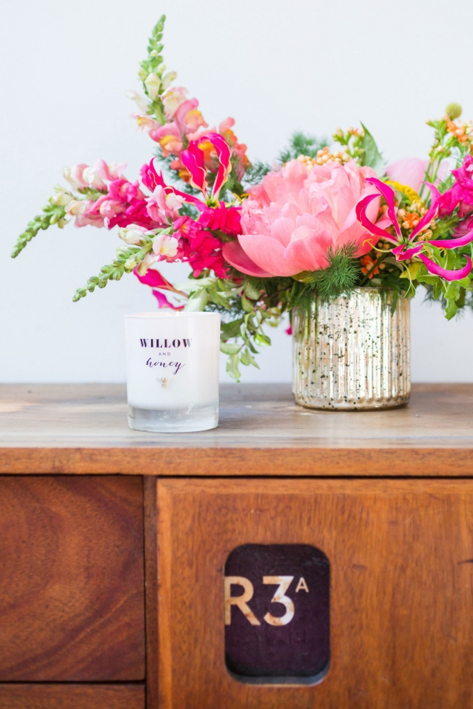 Posy of peonies and stocks and lilies with willow and honey scented candle set the right vibe for sophie robinsons Colour Psychology for creative interiors event