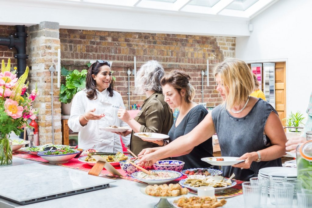 Guests enjoying a buffet lunch from Hampstead Kitchen at the papermill studios in central london. All part of the colourful Colour Psychology course for interior designers
