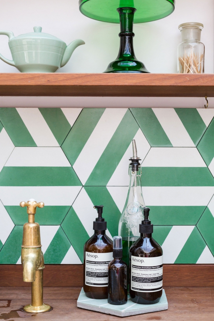 Geometric patterned tiles form a kitchen splash back at the papermill studios in london