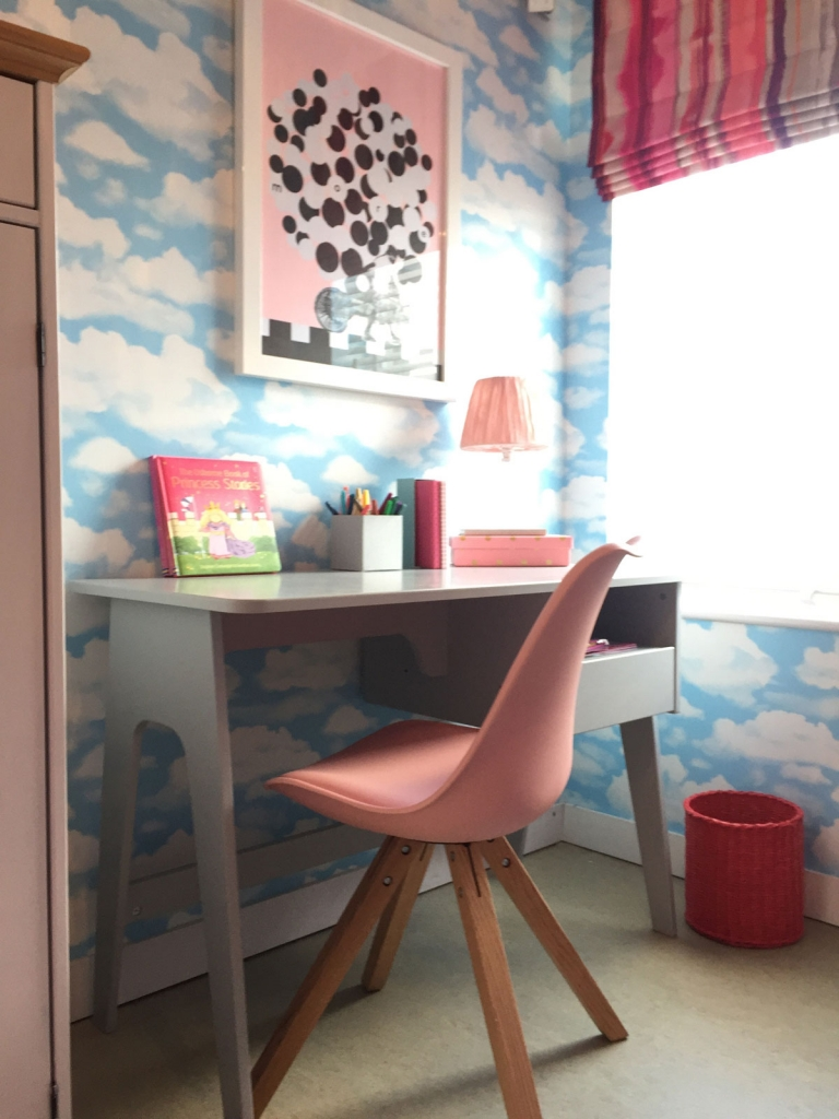 Simple shaped furniture and modern graphic prints keep the look cute and not too frilly