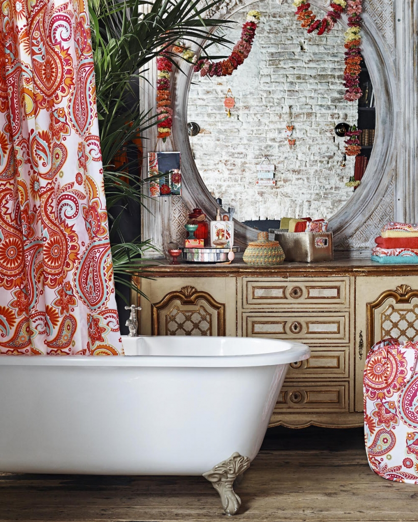 the autumn personality, according to colour psychology loves paisley prints and ethnic artefacts. period details appeal too like this roll top bath and old side board with plenty of patina. Image by Emily Henson for Primark