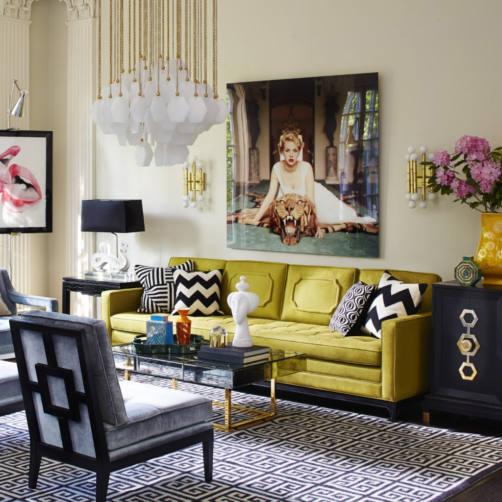 The striking yellow sofa and glossy artwork dipicts the glamour of the winter personailty. Sharp lined furniture and geometric zig zag chevron cushions all make up this glamourous living room designed by Jonathon Adler