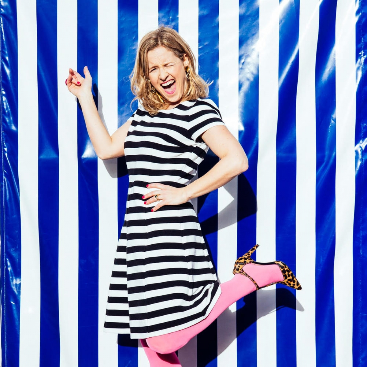 Interior designer Sophie robinson shares her interior design crimes. black and white striped dress, neon pink tights and leopard print heels