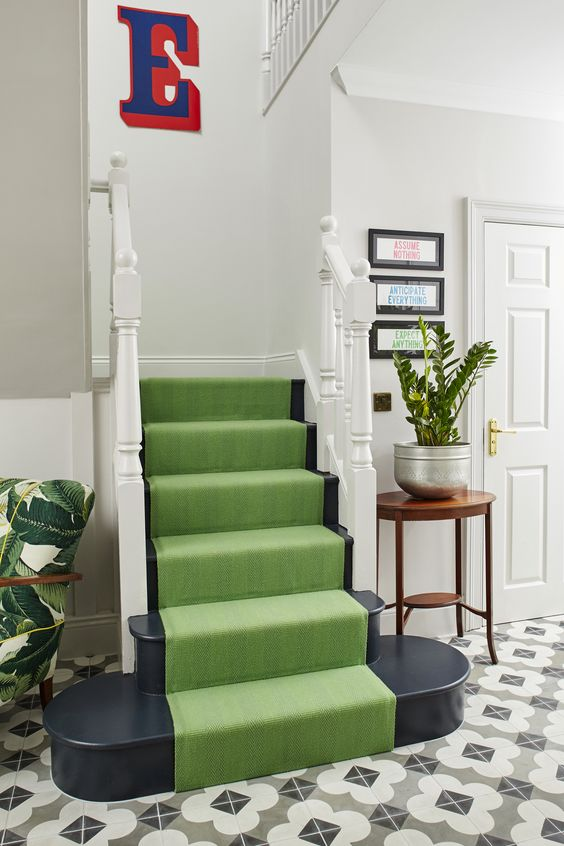 Green stair runner and black and white patterned cement tile floor in the home of fashion stylist Erica Davies