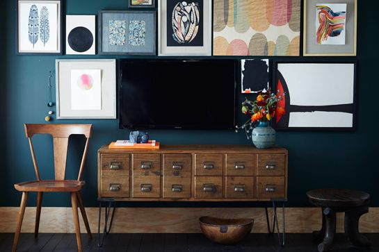 Place the Tv against a dark wall and camaflage in in a gallery wall of pictures