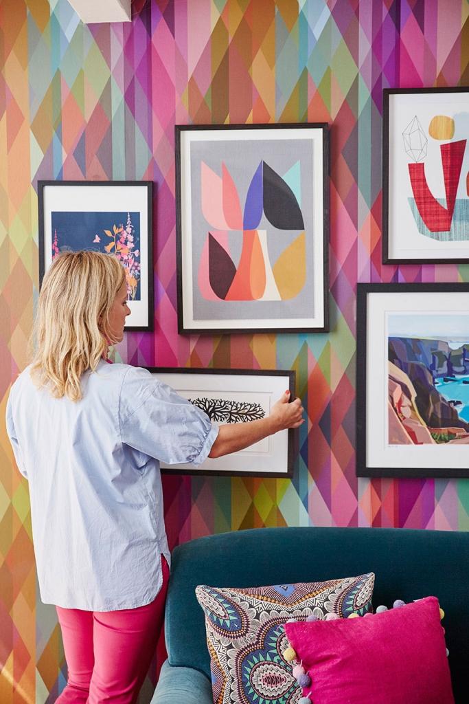 interior designer sophie robinson shows how you create a gallery wall of artwork for your interior design scheme