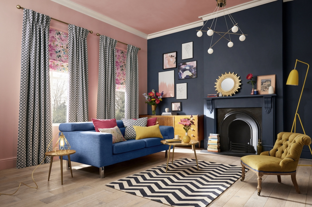 Interior designer Sophie Robinsons designs this interior designed room set in her colour clashing favourite shades of deep blue and pink. Complete with chevron rug and accents of yellow the style is eclectic and vintage. Great use of mixing fabrics