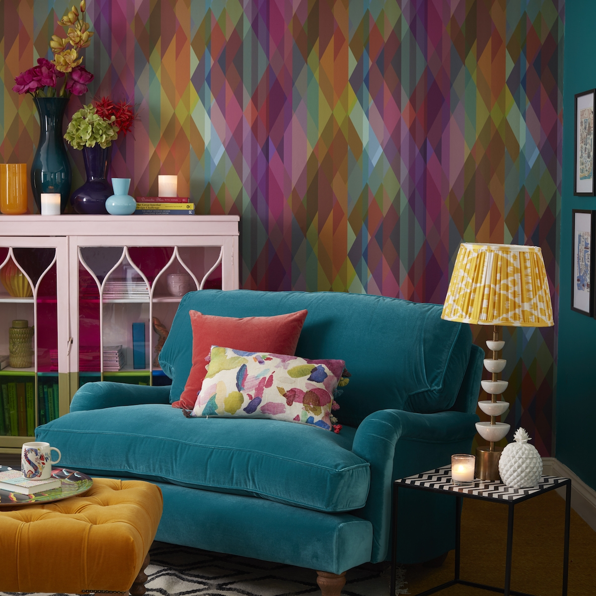 cosy corner of a living room designed by Sophie Robinson. Cole and son prism wallpaper and bluebell snuggler from sofa.com