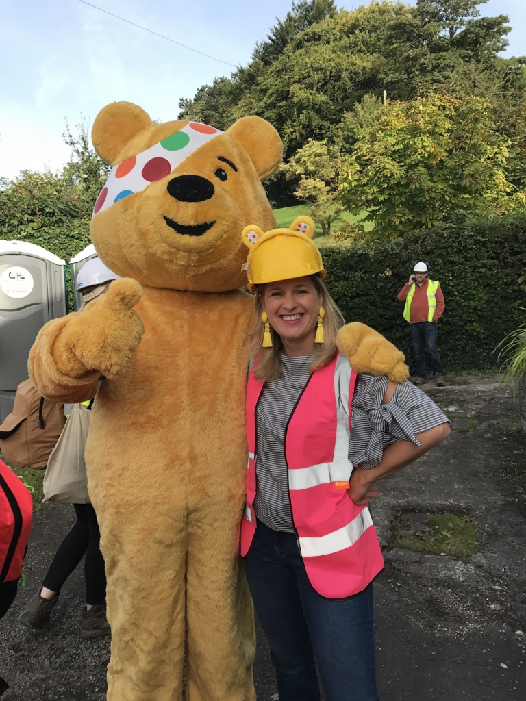 Interior designer Sophie Robinson with Pudsey bear for children in need DIY SOS
