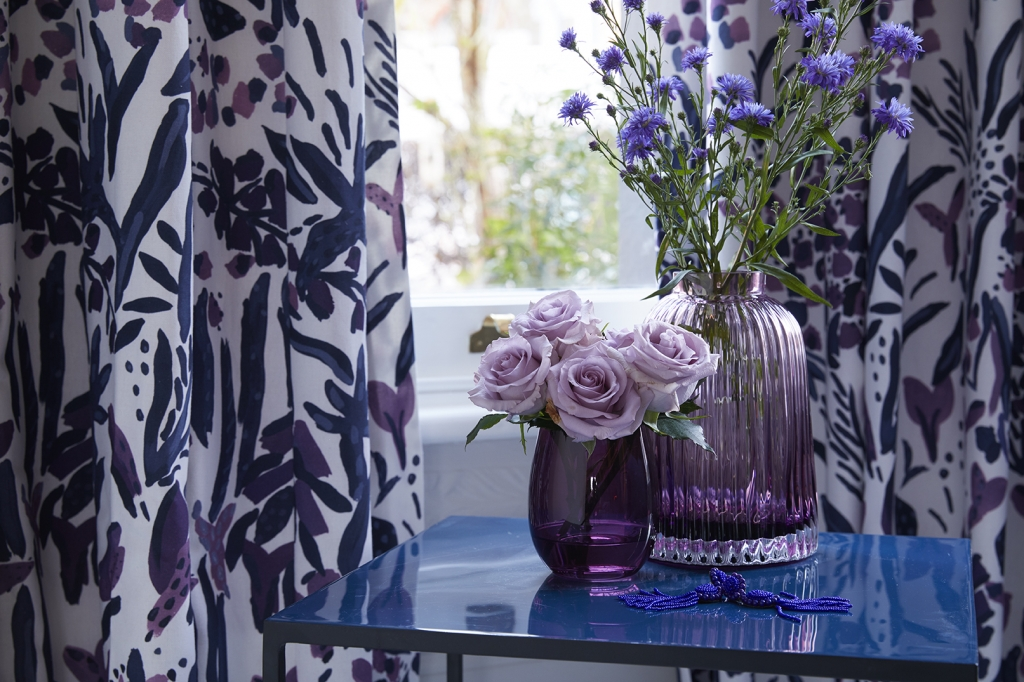 pantone of colour of the year 2018 is utra violet a bright and intense purple. lilac coloured rsoses and intense purple flowers in vases create the look
