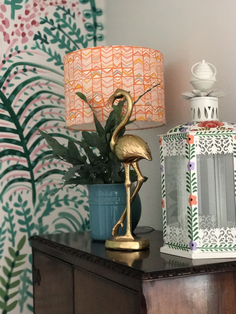 gold flamingo ornament adds a quirky charm to a botanical theme