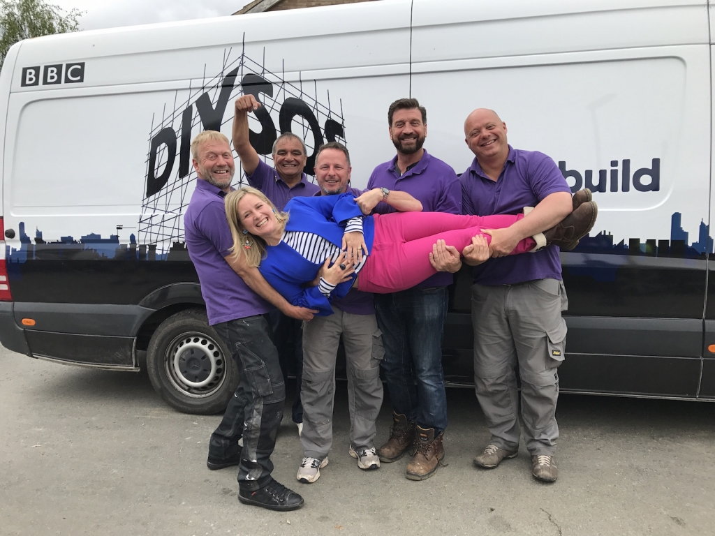 Interior designer Sophie robinson with the DIY SOS boys CHris, Billy, Mark, Nick Knowles and Chris.