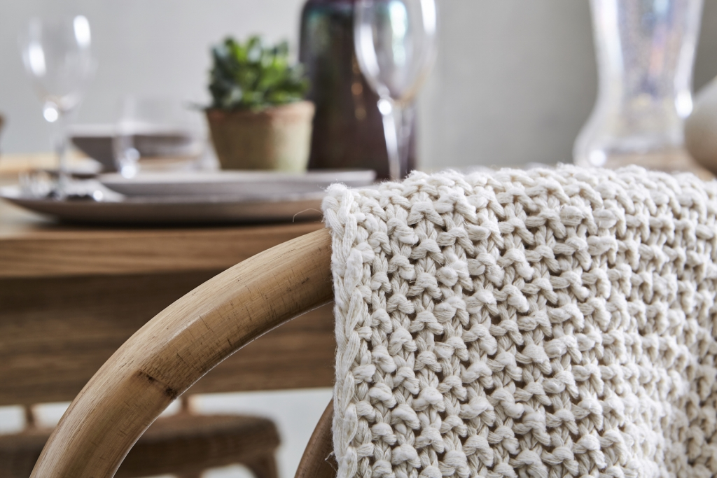 soft cotton chunky knit throw gives a realxed vibe to a summer setting